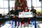 Stater Bros. Chairman and CEO Jack H. Brown recently presented a $26,000 check from Stater Bros. Charities to the United States Marine Corps.  Accepting the check were (L-R) USMC Staff Sergeant Bradley Nevitt, USMC Captain Michael Gocke, and USMC Gunnery Sergeant Kian Adyani.  (PRNewsFoto/Stater Bros. Charities)