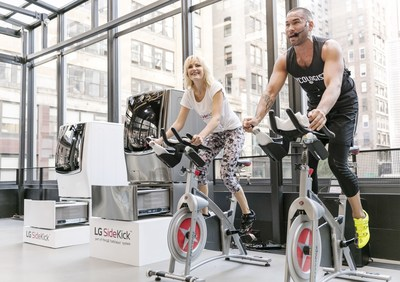 Malin Akerman, left, star of Showtime's hit show Billions, spins tirelessly alongside Cyc Fitness founder Keoni Hudoba at LG's 'Fit-Fashion' event Wednesday, June 29, 2016 in New York. A celebrity fitness enthusiast, Malin uses the LG SideKick to protect her favorite workout gear with its Active Wear-specific cycle.