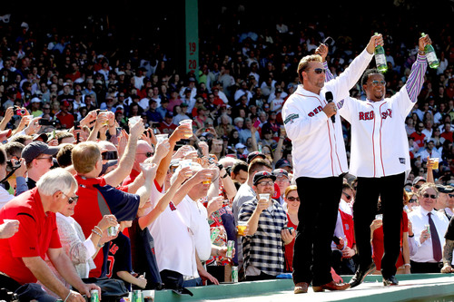 Former Red Sox players Kevin Millar and Pedro Martinez toast to Fenway Park's 100th anniversary with Welch's Sparkling Grape Juice. Photo Credit: Billie Weiss.  (PRNewsFoto/Welch's, Billie Weiss)