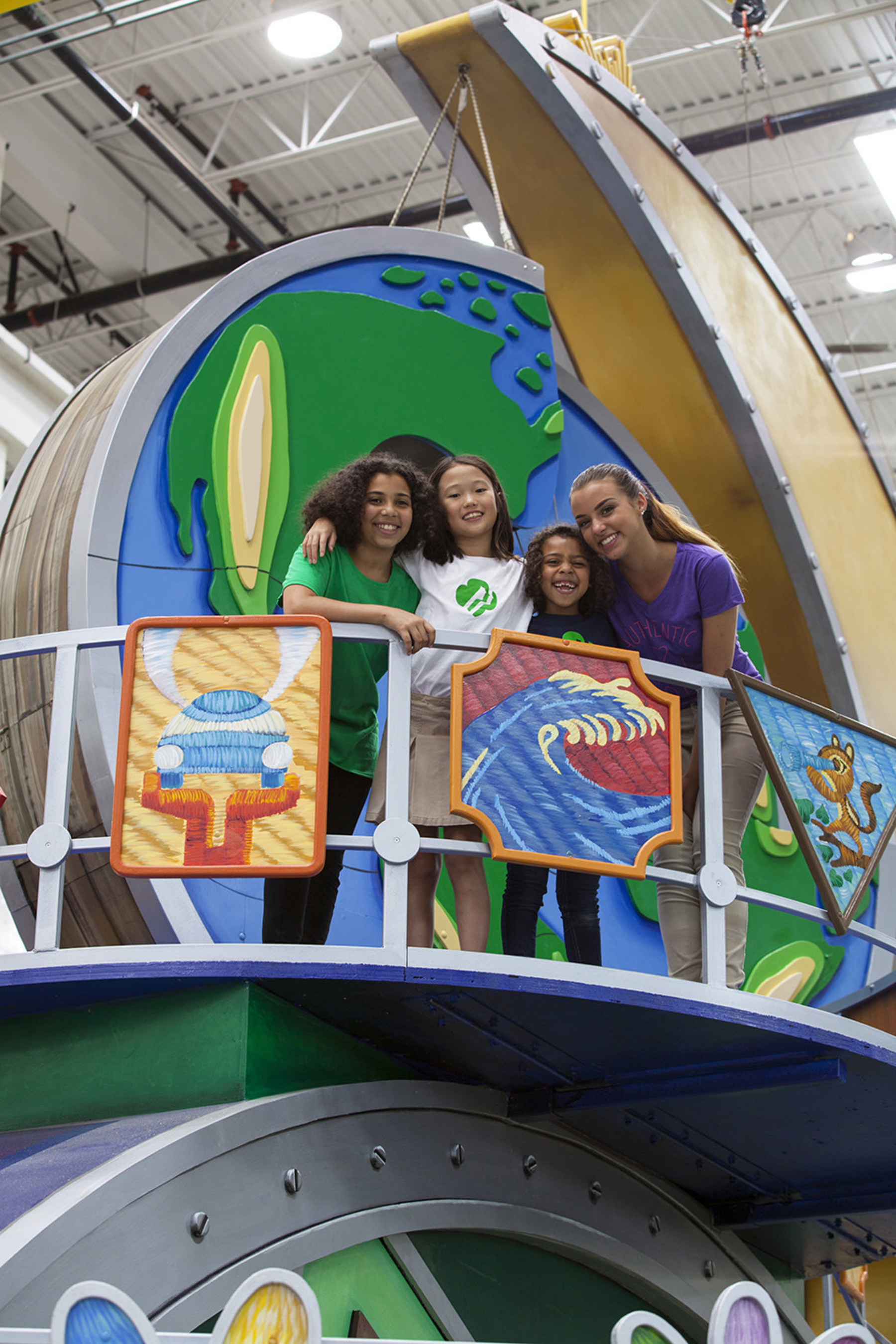 In addition to the giant 3-D puzzle pieces of the globe, the float features two dozen Girl Scout badges, representing everything from STEM and the outdoors to financial literacy and entrepreneurship, a friendship circle, and a Gold Award symbol that marks this year's centennial.