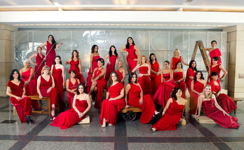 EHE International Celebrates 100 Years with its 10th Anniversary Red Dress Campaign in Honor of Heart Health Month.  (PRNewsFoto/EHE International)
