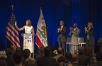 First Lady Michelle Obama greets the crowd at the Unite for Veterans Summit today in Los Angeles. Also on stage are The Honorable Eric Garcetti, Mayor of Los Angeles; Matthew Smith, a veteran; and Elise Buik, CEO of United Way of Los Angeles, the event host. (PRNewsFoto/United Way Greater Los Angeles)