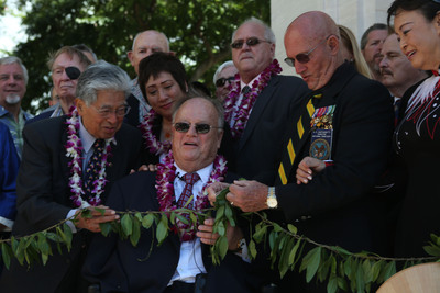 """Honolulu, Nov. 11 - Flanked by veterans, Senator Daniel Akaka, Congresswoman Colleen Hanabusa, American Battle Monument Commission Secretary Max Cleland, and National Memorial Cemetery of the Pacific Superintendent Gene Castagnetti untie a """"maile lai"""" officially dedicating the new Vietnam War pavilion at the Honolulu Memorial following the annual Veterans Day ceremony on Sunday.  The new Vietnam War pavilion combined with the already existing Vietnam War Courts of the Missing at the Honolulu Memorial constitute the only federal memorial to veterans of the Vietnam War built solely with federal funds (Official American Battle Monuments Commission photograph).  (PRNewsFoto/American Battle Monuments Commission)"""