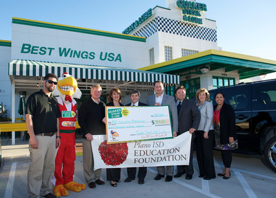 Quaker Steak & Lube donation to the Plano Independent School District in Plano, Texas.  (PRNewsFoto/Quaker Steak & Lube)
