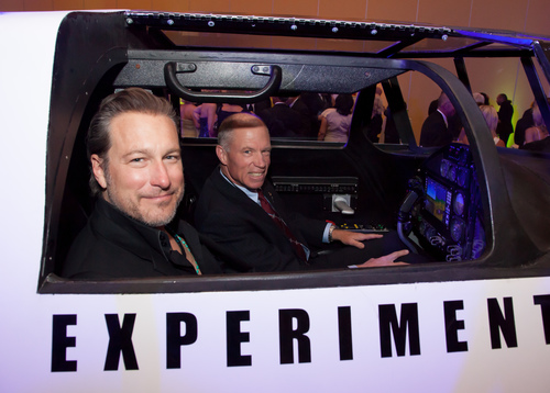 Actor and musician John Corbett and XCOR Chief Test Pilot Richard Searfoss climb aboard the Lynx replica at Celebrity Fight Night XX on Saturday, April 12th in Phoenix, Arizona. (PRNewsFoto/XCOR Aerospace)