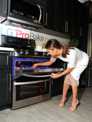 Eva Longoria cooks up her signature pan de polvo recipe, from her cookbook 'Eva's Kitchen,' with guests at the LG Fam-to-Table Series: ProBake Edition event celebrating LG's new line of ProBake Convection(TM) ranges on August 22, 2015, in Los Angeles; this new range is designed to help home chefs achieve more professional cooking and baking results at home.