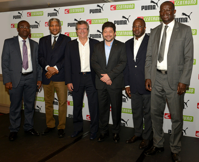 Centauro owner Sebastiao Bomfim with the PUMA CCO Stefano Caroti (centre) at a sub-licensing commercial announcement involving the presidents of Ghana (Kwesi Nyantakyi), Cameroon (Mohamed Iya), Ivory Coast (M. Malick Tohe) and Senegal (Augustin Senghor)