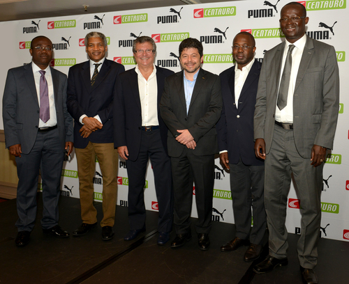 Centauro owner Sebastiao Bomfim with the PUMA CCO Stefano Caroti (centre) at a sub-licensing commercial announcement involving the presidents of Ghana (Kwesi Nyantakyi), Cameroon (Mohamed Iya), Ivory Coast (M. Malick Tohe) and Senegal (Augustin Senghor) (PRNewsFoto/PUMA SE)