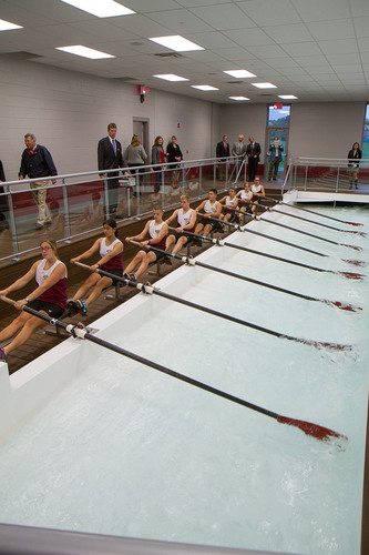 CULVER, Ind. - Members of the Culver Academies rowing team demonstrate how the indoor rowing tanks are used during the White-DeVries Rowing Center open house following the dedication ceremony. The 24,000 square-foot building houses two eight-person rowing tanks -- the first in Indiana and one of the few in the Midwest. The college-preparatory boarding school offers boys and girls rowing in the fall and spring.  (PRNewsFoto/Culver Academies)