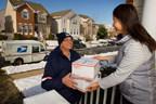 U.S. Postal Service letter carrier delivering packages during the holidays
