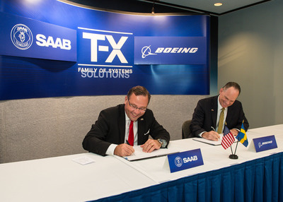 Hakan Buskhe, President and Chief Executive Officer of Saab and Boeing Military Aircraft President Chris Chadwick sign Joint Development Agreement on T-X Family of Systems Training Competition.  (PRNewsFoto/Saab)