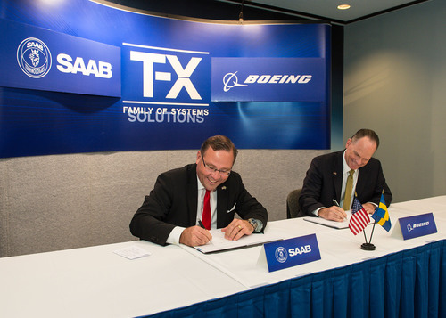 Hakan Buskhe, President and Chief Executive Officer of Saab and Boeing Military Aircraft President Chris ...
