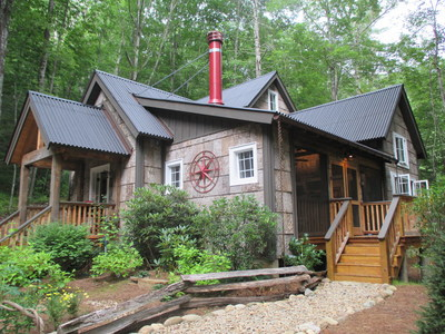 Blue Ridge Log Cabins' custom, all poplar bark home, winner of a Jerry Rouleau Award for Excellence in Home Design.