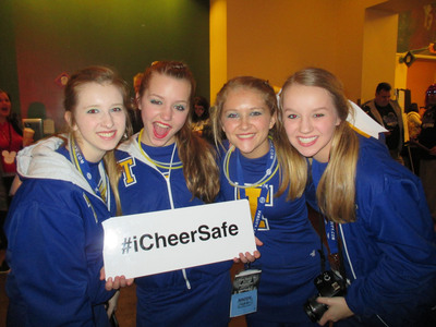 """In celebration of National Cheerleading Safety Month, Varsity has partnered with CheerSafe, to promote its iCheerSafe pledge which encourages cheerleaders to take """"Safety Selfies"""" photos holding #iCheerSafe signs to proudly support their dedication to safety and inspiring other athletes to do the same. Cheerleaders are being encouraged to tweet their 'selfies' with the hashtag #iCheerSafe. Photos will be featured on the CheerSafe.org site and retweeted by @CheerSafe and @USACheer.  (PRNewsFoto/Varsity)"""