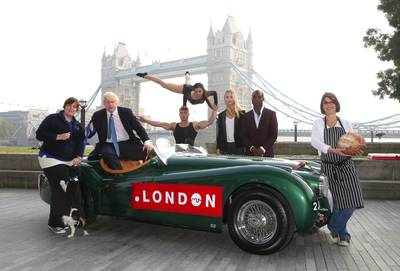The Mayor of London Boris Johnson in the driving seat of a Jaguar XK120 from London business Hexagon Classics surrounded by representatives from other companies that have acquired a Dot London address outside City Hall to launch the Dot London domain worldwide. PRESS ASSOCIATION Photo. Picture date: Thursday September 18, 2014. Interest in Dot London has been strong from the start and on the first day the new domain name went on general availability over 9000 domains were registered making a total of over 44,000 registrations now received. Leading businesses that have signed up include Fortnum & Mason, KPMG, Metro Bank, Cath Kidston, ZSL London Zoo, the menswear clothing firm Dunhill, The Royal College of Art, and Storm Models. (PRNewsFoto/Dot London)