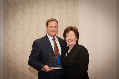 Experian honored by the National Foundation for Credit Counseling (NFCC) for empowering consumers to better manage their financial lives. Victor Nichols, Experian's North American CEO pictured with Susan Keating, President and CEO of the NFCC.  (PRNewsFoto/Experian/Champa Street Productions)