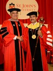 "Peter P. D'Angelo, Chair of the Board of Trustees, congratulates St. John's University President Conrado ""Bobby"" Gempesaw, Ph.D. at the completion of his official investiture."