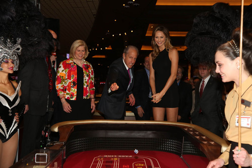 David Cordish, Chairman of The Cordish Companies, is joined by actress Stacy Keibler (R) and Anne Arundel County Executive Laura Neuman (L) as he rolls the ceremonial first dice to open live table games at Maryland Live! Casino in Hanover, MD.  (PRNewsFoto/Maryland Live! Casino)