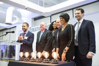 Lamp lighting at Spark Baltimore grand opening.
