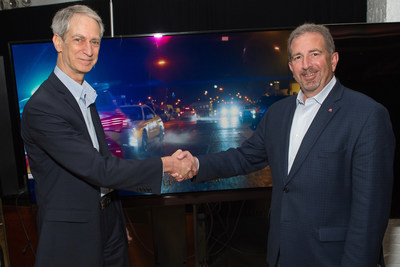 Value Electronics Owner Robert Zohn (left) presents the 2016 TV Shootout™ award for the LG SIGNATURE OLED TV (model OLED65G6P) to Tim Alessi, Senior Director, Product Marketing for home entertainment, LG Electronics USA (right).