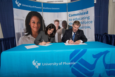 Kim Owens, Vice President of the Workforce Solutions Community College Center of Excellence, University of Phoenix, and Dr. Joe May, President of the Louisiana Community & Technical College System.  (PRNewsFoto/University of Phoenix)