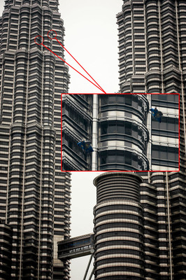 Wingsuit visits Malaysia's tallest and most iconic building Petronas Twin Towers.  (PRNewsFoto/Red Bull Energy Drink)