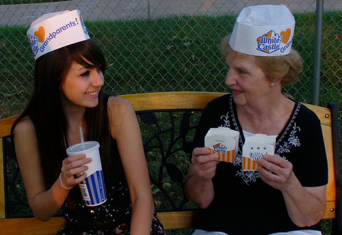 Breanna Litzau and her grandmother take a timeout to enjoy some White Castle Sliders near St. Louis, Missouri. White Castle is celebrating Grandparents Day with specials for grandparents and their grandchildren Sunday, September 9. The first 100 grandparents and grandchildren to celebrate the holiday receive a vintage-inspired White Castle 'I Heart Grandparents' cap. Grandparents can download a coupon, valid September 9 only, for four Original Sliders for $1 from the White Castle website or Facebook page.  (PRNewsFoto/White Castle)