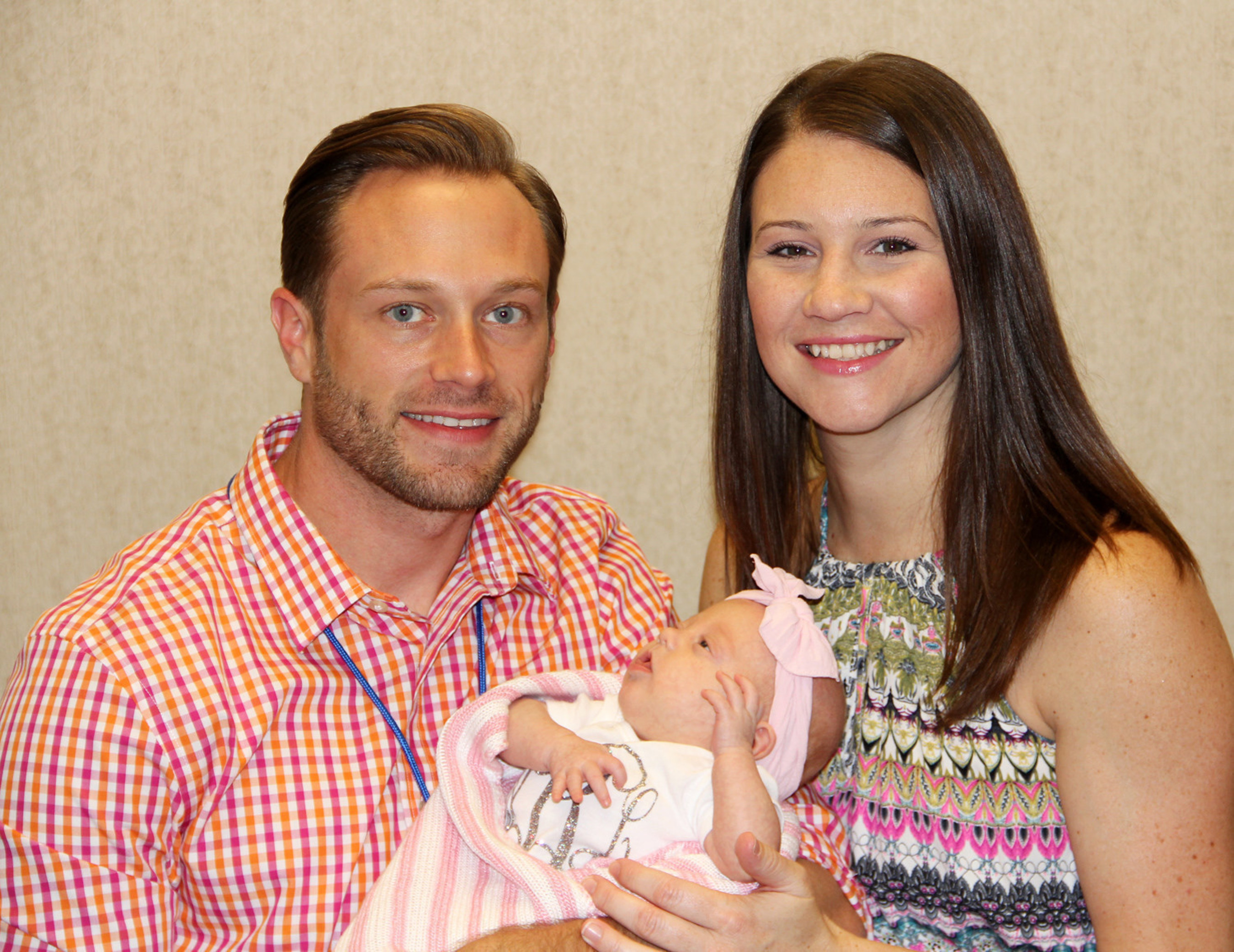 Parents Adam and Danielle Busby take Ava Lane home today.