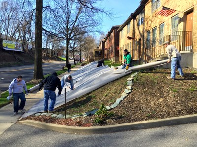 Wounded Warrior Project Alumni volunteers take part in landscaping project at Veterans Place.