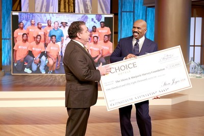 Choice Hotels President and CEO presents donation for the Steve & Marjorie Harvey Foundation