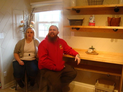 Brandon and Laura Burns enjoy their new desk and shelves