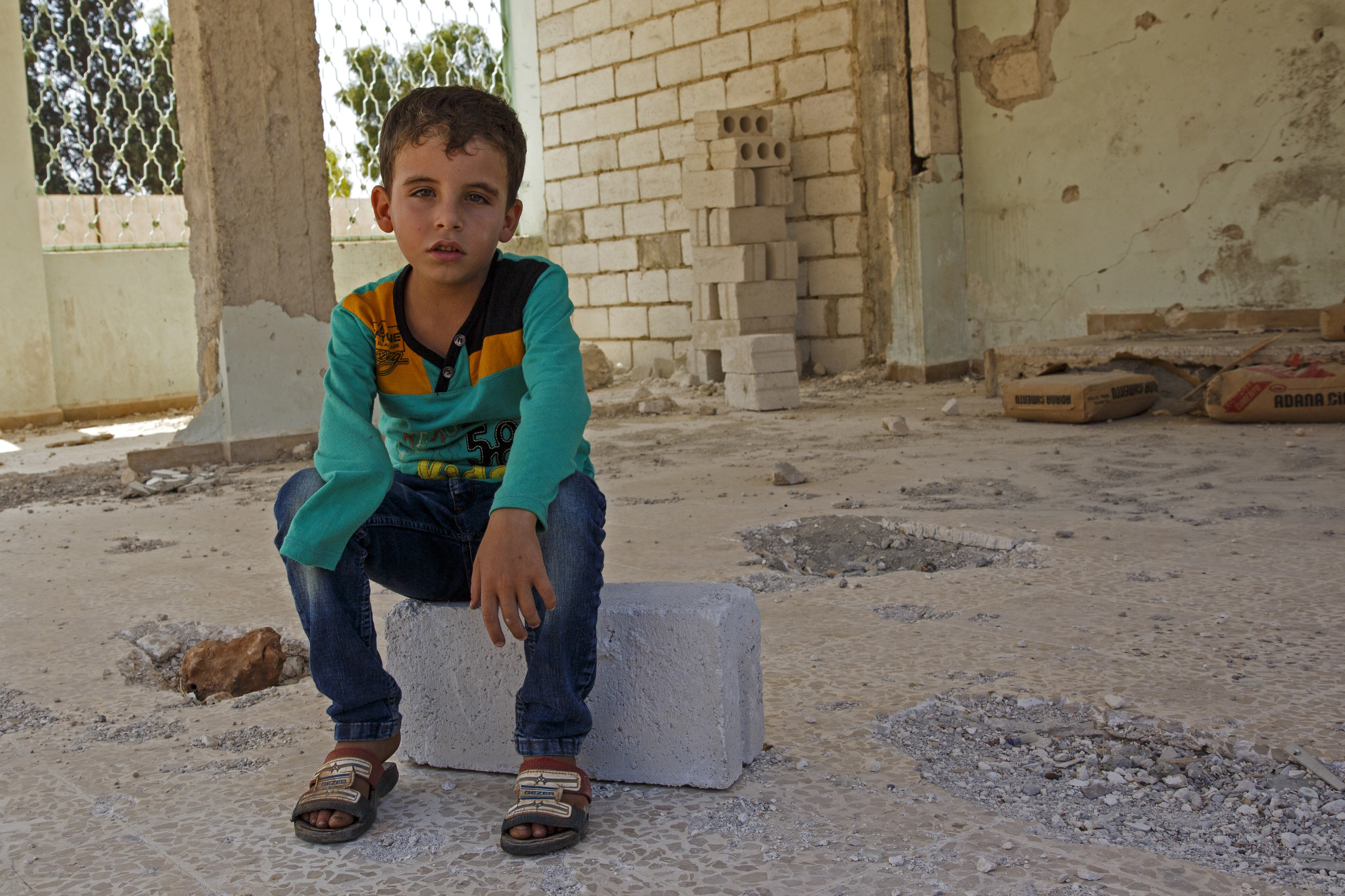 Khalid*, 7, suffered severe injuries and lost his hand when his school in northern Syria was attacked in March 2015. Photo by Ahmad Baroudi/Save the Children (* after a name indicates that the name has been changed to protect identity).