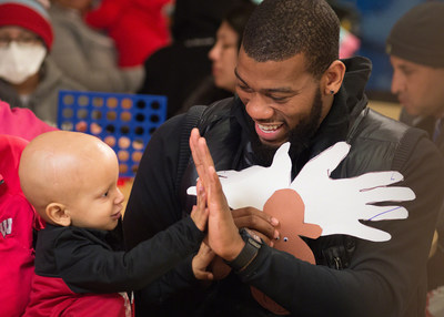 St. Jude ambassador Greg Monroe of the Milwaukee Bucks shares a special moment with St. Jude patient Colton during a recent team visit to St. Jude Children's Research Hospital in Memphis, TN.