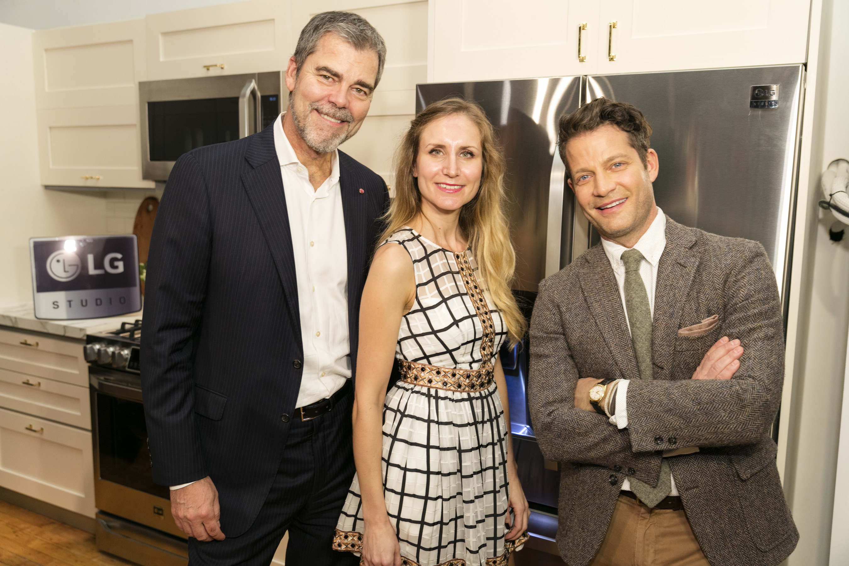 """""""Designed to Inspire"""" LG Studio Kitchen Design Contest grand prize winner, Petya Toncheva, poses with renowned designer and LG Studio Artistic Advisor Nate Berkus and LG Electronics' Vice President of Marketing Dave VanderWaal  at the """"Designed to Inspire"""" event held at The Kitchen at Union Square on Thursday, November 19, 2015. The contest challenged up-and-coming American Society of Interior Designers New York Metro Chapter designers to create a forever kitchen design, using the new premium LG Studio kitchen appliance suite as the centerpiece. (Photo Zack Seckler for LG Electronics)"""