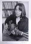 Included in the Lot: Signed and matted Photo by Jim Marshall of Joan Baez, 1968, playing the Martin 0-40 guitar.