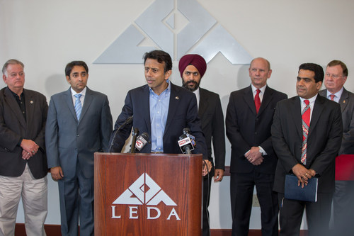Louisiana Governor Bobby Jindal and Enquero executives jointly announce Enquero's first Agility Development Center in Lafayette. (Photo courtesy of Gov. Bobby Jindal's office) (PRNewsFoto/Enquero Inc.)