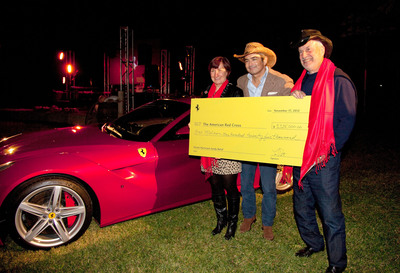 (from Left) Marty McKellips, CEO of the Red Cross of Central Texas; Marco Mattiacci, President & CEO of Ferrari North America; and Larry Roth of Long Island, New York, who placed the winning bid of $1.25 million for the USA's first Ferrari F12berlinetta to benefit the American Red Cross/Hurricane Sandy relief.  (PRNewsFoto/Ferrari North America)