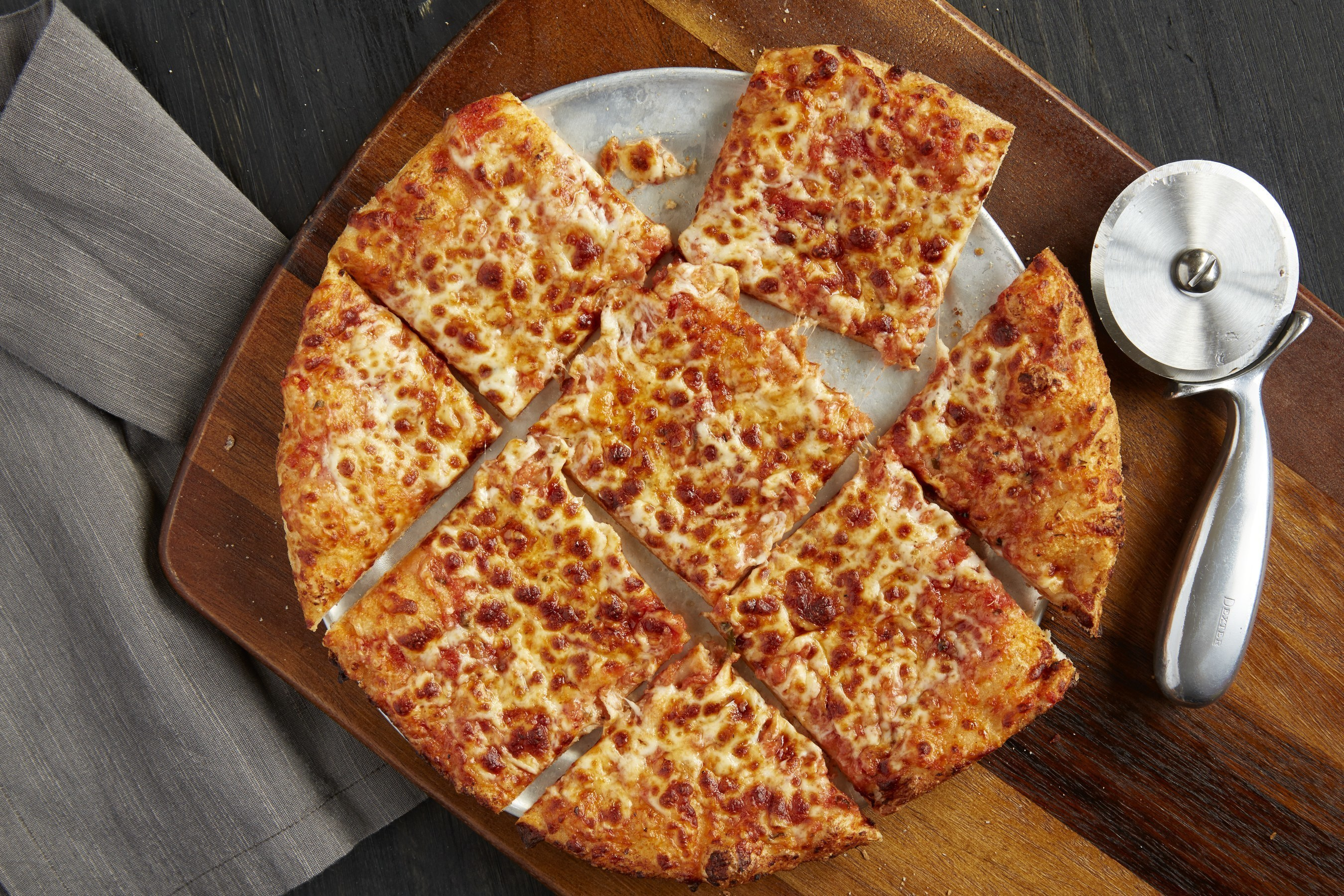 UNO Northside Cheese Thin Crust Pizza:  A blend of mozzarella, aged cheddar, Romano cheese and tomato sauce.