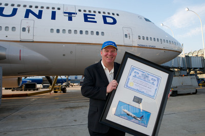 United customer Tom Stuker poses in front of a Boeing 747 bearing his name July 9, 2011. Stuker this month became the first customer to fly United 1 million miles in a year.  (PRNewsFoto/United Continental Holdings, Inc.)