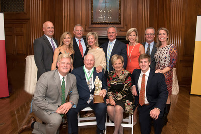 The Honorable Francis X. Kelly Jr. and his wife Janet, Co-Founders of Kelly & Associates Insurance Group surrounded by their four sons, (L-R) Bryan, David, Frank III and John, their wives, Heidi, Melissa, Gayle and Tee, and two of their grandchildren, David Kelly, Jr. and Patrick Kelly at The Candlelight Reception of Honor.