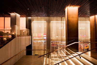 The Row NYC hotel's ultra contemporary lobby captures the buzz of Times Square.