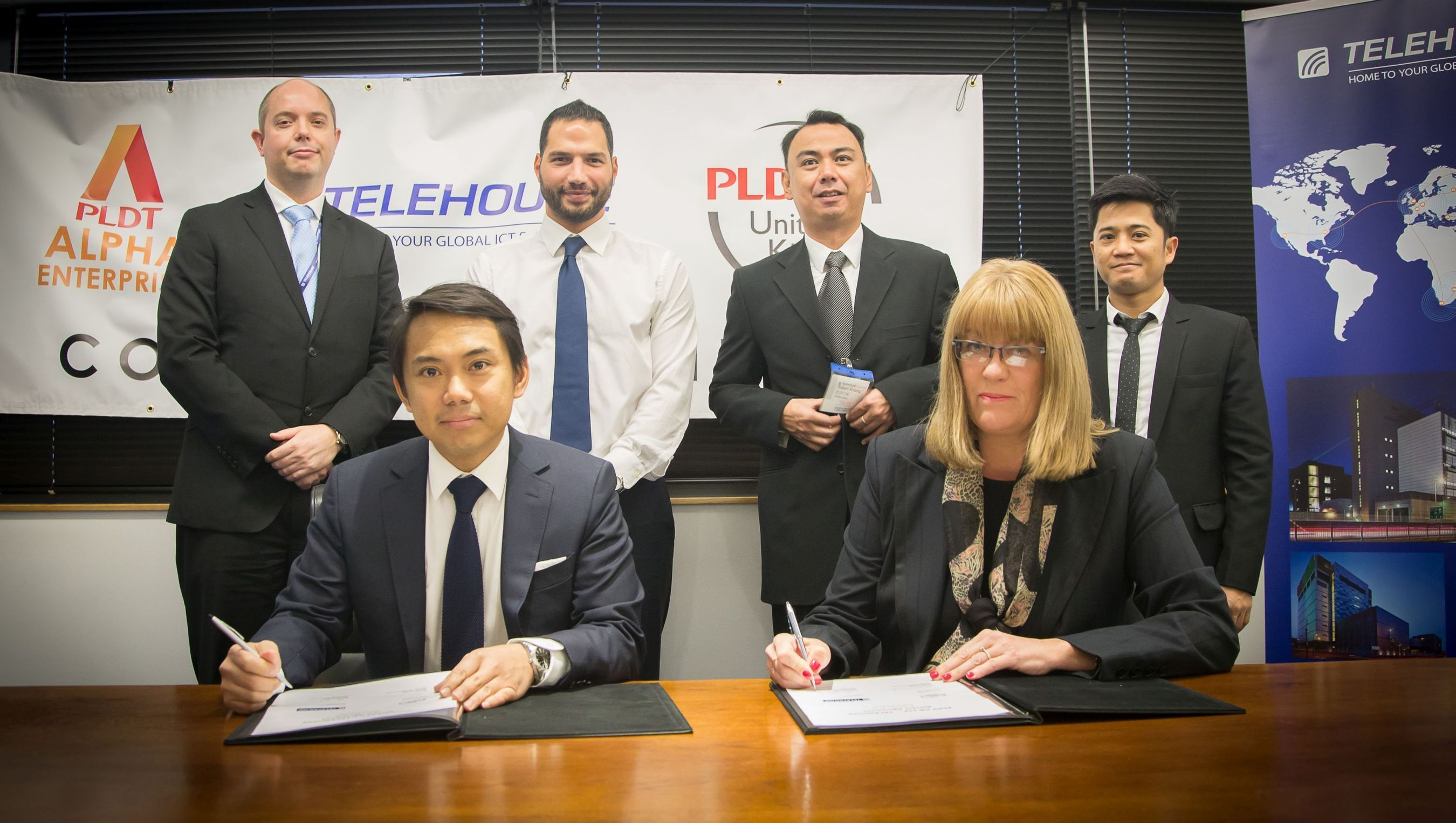 (L to R) William Horley, Marketing Manager at Telehouse; Oliver Calma, General Manager at PLDT UK, Vance Davis, International Account Manager at Telehouse; Roberto Alvarez, Sales, PLDT UK; Michelle Reid, Sales and Marketing Director at Telehouse and Roberto Gabriel, Head of IT at PLDT UK at the contract signing. (PRNewsFoto/Telehouse)