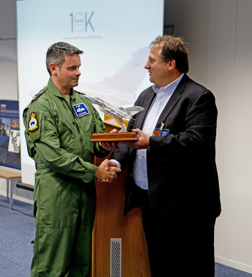 UTC Aerospace Systems Vice President of Airborne Systems, Kevin Raftery (right), presents a Silver Tornado statue to Group Capt. Rich Davies (left), British Royal Air Force, in commemoration of the company's DB-110 reconnaissance imaging system attaining over 10,000 flight hours on the RAF's Tornado jet fighters.  (Photograph courtesy of UTC Aerospace Systems)
