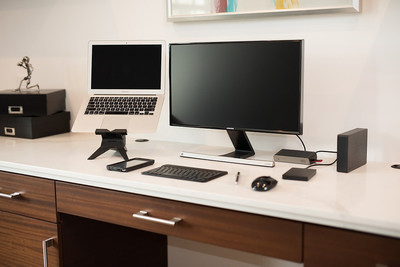 A home workspace setup -- complete with a universal docking station, a laptop, laptop stand, monitor, and wireless keyboard and mouse -- can improve the productivity of remote workers.