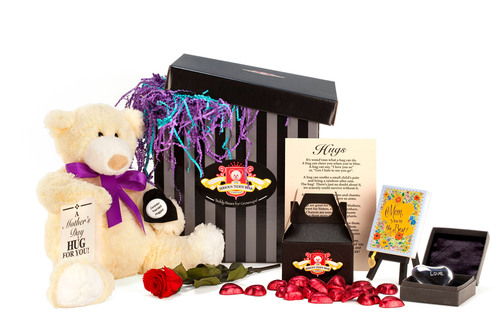 "The Ultimate Mother's Day Gift. Mom deserves more than one day of appreciation. Our Mother's Day gift package includes our delightfully squeezable teddy bear and our favorite book for moms, ""Mom You're the Best."" We top this unique Mother's Day gift off with a Mother's Day Hug-Gram, a black gift box filled with solid chocolate hearts, a keepsake Chiming Harmony Heart, and a preserved Real Rose.  (PRNewsFoto/The Serious Teddy Bear Company)"