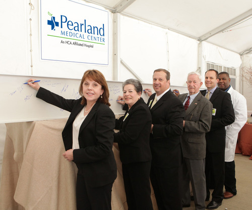 Left to right: HCA Gulf Coast Division President, Maura Walsh; Manvel Mayor, Delores Martin; Hospital Board of Trustees Chairman, Kevin Fuller; Pearland Mayor, Tom Reid; Pearland Medical Center CEO, Matt Dixon; and Hospital Chief of Staff, Earl Miller, M.D.; sign the steel.  (PRNewsFoto/HCA Gulf Coast Division)