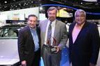 "Ricardo Rodriguez-Long (left) and Jaime Florez (right) present the Hispanic Motor Press Award ""Best Luxury Car"" for the 2015 Genesis to Dave Zuchowski, president and CEO, Hyundai Motor America (center)."