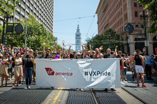 "Virgin America's SF Pride contingent with more than 200 teammates, friends and family on hand to help SF Pride parade revelers ""buckle up, to get down."" For the seventh consecutive year Virgin America has partnered with SF Pride as the ""Official Domestic Airline of San Francisco Pride."" Joining Virgin America's parade contingent this year will be American Idol season nine alum and #VXSafetyDance Safety Video star, Todrick Hall. (PRNewsFoto/Virgin America)"