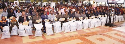 The large group of deportees gratefully receive individual cash gifts of N150,000 ($500USD) and two bags of rice after sharing their sordid experiences at The Synagogue, Church Of All Nations (SCOAN). (PRNewsFoto/Emmanuel TV)