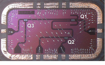 A picture of the IBM Silicon chip housing a total of three qubits. The chip is back-mounted on a PC board and connects to I/O coaxial lines via wire bonds (scale: 8mm x 4mm). A larger assembly of such qubits and resonators are envisioned to be used for a scalable architecture.(PRNewsFoto/IBM)
